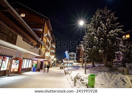 Saas Fee, Switzerland - Dec 24 : the resort Saas Fee pictured on December 24th, 2014, in Saas Fee, Switzerland. One of the most popular ski resort of Switzerland, it is now celebrating its 30 years.  - stock photo