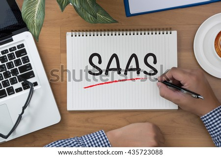 SAAS man hand notebook and other office equipment such as computer keyboard - stock photo