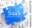 SAAS - Software-as-a-Service - Written on Blue Puzzle Pieces. Information Technology Concept. 3D Render. - stock