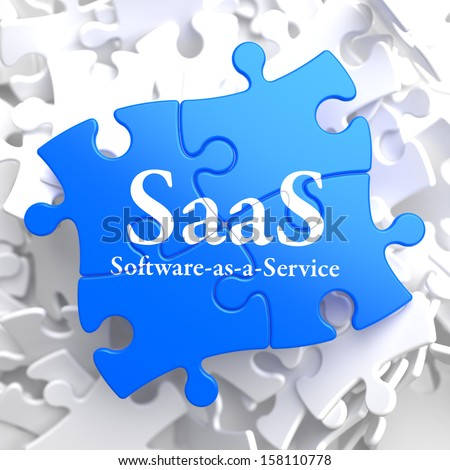 SAAS - Software-as-a-Service - Written on Blue Puzzle Pieces. Information Technology Concept. 3D Render. - stock photo