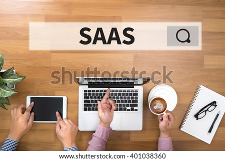 SAAS Two Businessman working at office desk and using a digital touch screen tablet and use computer - stock photo