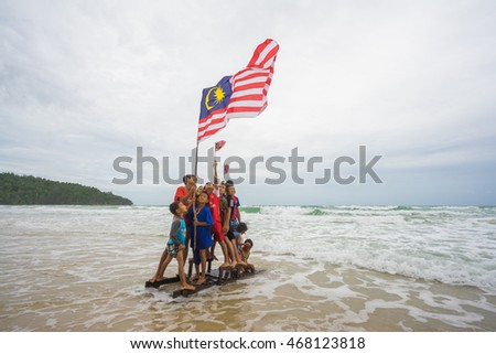 Sabah, Malaysia : 06 August 2016 : Malaysian kids standing with waving Malaysia Flag. Independence Day celebration