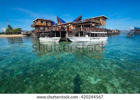 Sabah, Malaysia - 15 May 2016 : Amazing view of resort in Mabul Island in crystal sea water. It amazing place to transit to Sipadan Island one of the ten most beautiful islands in world.