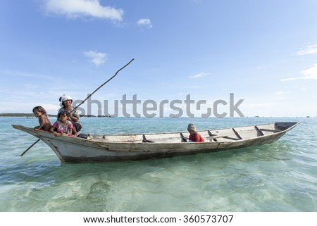 Sabah, Malaysia-October 29, 2011:Unidentified Borneo Sea Gypsy family on a canoes in Omadal Island, Sabah Borneo, Malaysia. They living on long boats know as lepa lepa in the middle of ocean.