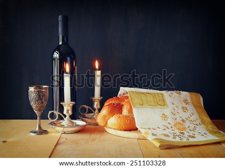 Sabbath image. challah bread, sabbath wine and candelas on wooden table  - stock photo