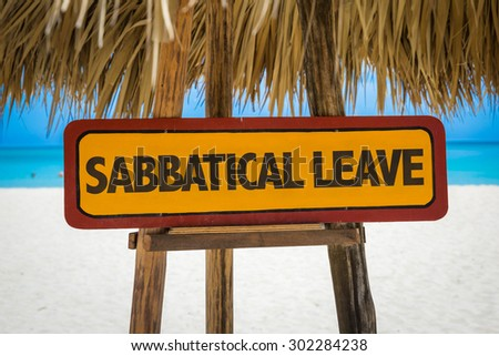 Sabbatical Leave sign with beach background - stock photo