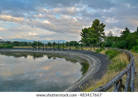 Sabina (Lazio, Italy) - Baccelli artificial lake with cloudy landscape