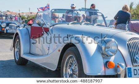 "Sables d Olonne, France  - September 23, 2016 : English vintage car rally in the streets of the city, ""A Nous les Belles Anglaises"" - parade of beautiful old English cars"