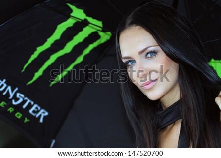 SACHSENRING - GERMANY, JULY 13: Grid girl at 2013 Eni MotoGP of Germany at Sachsenring circuit on July 13, 2013 - stock photo