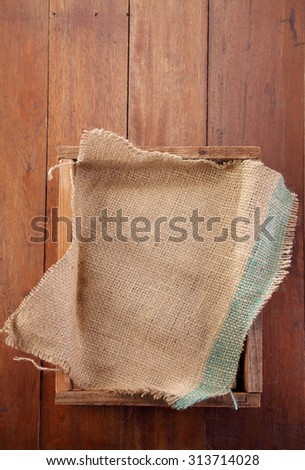 sack cloth on top of wooden crate - stock photo