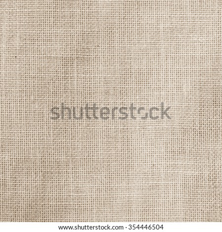 Sackcloth woven texture pattern background in light sepia tan beige cream brown color tone: Eco friendly raw organic flax sack cloth fabric textile: Bag rope thread detailed textured burlap canvas - stock photo