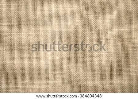 Sackcloth woven texture pattern background light cream yellow beige earth color tone: Eco friendly raw organic flax sack cloth fabric textile backdrop: Bag rope thread detailed textured burlap canvas - stock photo