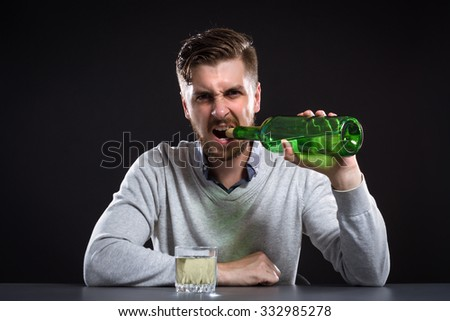 Sacked Manager Opens A Bottle Of Wine Teeth - stock photo