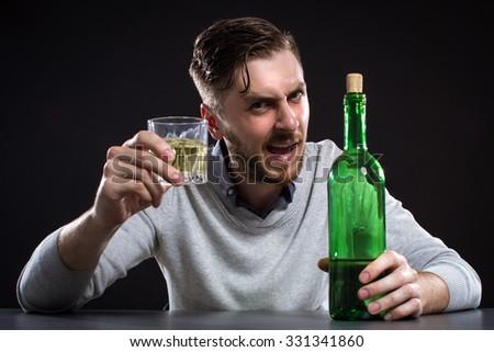 Sacked Manager With Bottle On Black Background - stock photo