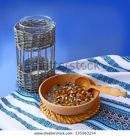 Sacral lean porridge from a wheat, poppy, nuts and honey, which is cooking in eve Christmas - stock photo