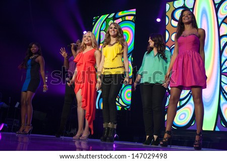 SACRAMENTO, CA -JULY 22:  The girls perform in the 2013 American Idol Tour at Sleep Train Arena in Sacramento, California on July 22, 2013 - stock photo