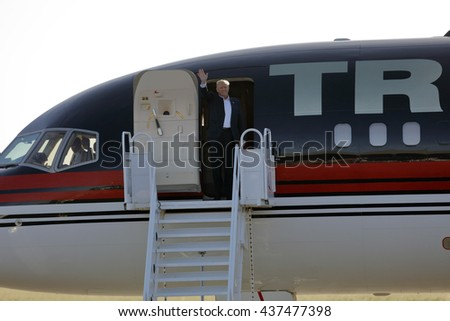 SACRAMENTO, CA - JUNE 01, 2016: Republican Presidential candidate Donald Trump arrives at a campaign rally in his  jet at airport hanger in Sacramento, California  - stock photo