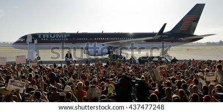 SACRAMENTO, CA - JUNE 01, 2016: Republican Presidential candidate Donald Trump speaks at a campaign rally in airport hanger in Sacramento, California - stock photo