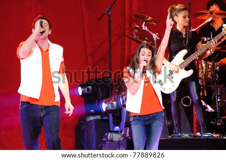 SACRAMENTO, CA - MAY 23: Corey Monteith and Lea Michelle perform at the Glee Live! In Concert! tour at the Power Balance Pavilion on May 23, 2011 in  Sacramento, California. - stock photo