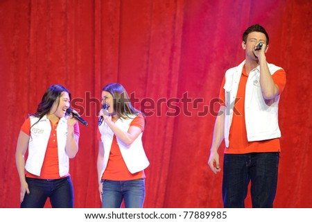 SACRAMENTO, CA - MAY 23: Jenna Ushkowitz, Lea Michele and Cory Monteith perform at the Glee Live! In Concert! tour at the Power Balance Pavilion on May 23, 2011 in  Sacramento, California. - stock photo