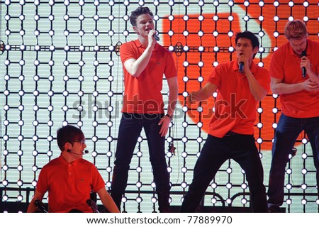 SACRAMENTO, CA - MAY 23: Kevin McHale, Chris Colfer, Harry Shum Jr. and  perform at the Glee Live! In Concert! tour at the Power Balance Pavilion on May 23, 2011 in  Sacramento, California. - stock photo