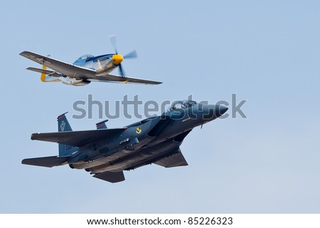 SACRAMENTO, CA - SEPT 10: P-51 Mustang WW II aircraft and F-15E Strike Eagle aircraft during heritage flight at the California Capital Airshow, on September 10, 2011 at Mather Airport, Sacramento, CA. - stock photo