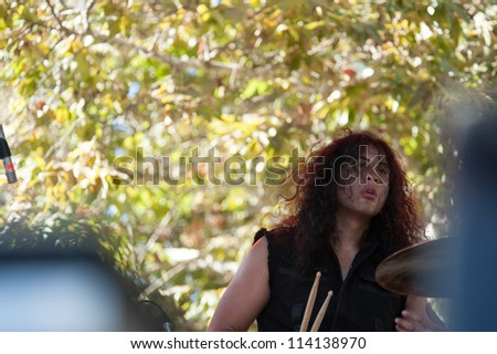 SACRAMENTO, CA - SEPTEMBER 23:  An unidentified drummer performs at the Aftershock music festival featuring Bush, Deftones, Stone Temple Pilots, and more at Discovery Park in  Sacramento, CA on September 23, 2012 - stock photo