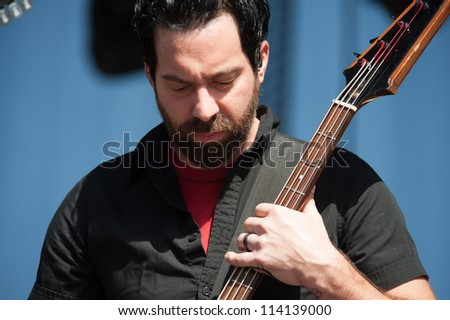 SACRAMENTO, CA - SEPTEMBER 23:Dean Bernardini of Chevelle performs as part of the Aftershock Music Festival at Discovery Park on September 23, 2012 in Sacramento, California. - stock photo