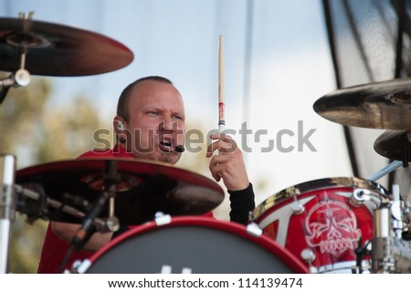 SACRAMENTO, CA - SEPTEMBER 23: Joey Dandeneau of Theory of a Deadman performs at Aftershock music festival featuring Bush, Deftones, at Discovery Park in  Sacramento, CA on September 23, 2012 - stock photo