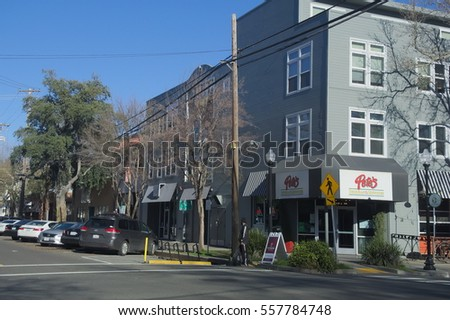 SACRAMENTO, CALIFORNIA - JANUARY 13, 2017: New housing, a boutique coffee roaster, and a restaurant anchor the corner 20th and J Streets in  trendy midtown Sacramento.