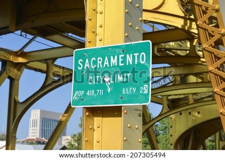 Sacramento City Limit Sign on the Tower Bridge over the Sacramento River in Sacramento, California. - stock photo