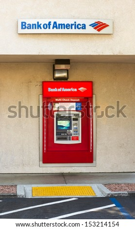 SACRAMENTO, USA - SEPTEMBER 5, 2013: Bank of America ATM machine. The Bank of America Corporation is an American corporation pronounced the second largest bank company in the United States by assets. - stock photo