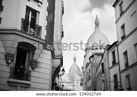 Sacre Coeur and old buildings in Montmartre (Paris, France) - stock photo