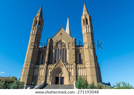 Sacred Heart Cathedral in Bendigo, Australia is the seat of the bishop of Sandhurst. Completed in 1977 in the gothic revival style, this church is the second tallest in Australia at 87m. - stock photo