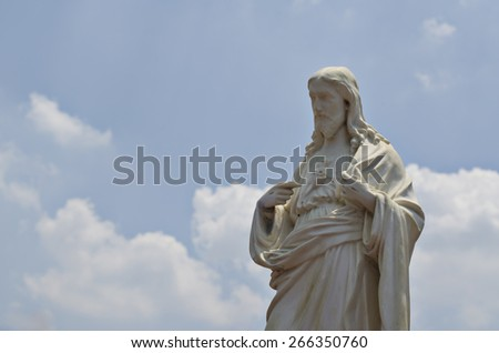 Sacred Heart of Jesus against the sky - stock photo