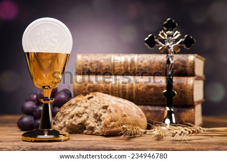 Sacred objects, bible, bread and wine. - stock photo