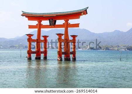 Sacred torii gate on the island of Miyajima (Itsukushima) during high tide, Japan - stock photo