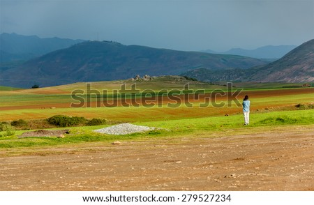 Sacred Valley of the Incas in the bad weather. View from ancient Inca circular terraces at Moray (agricultural experiment station) - Cusco Region, Peru  - stock photo