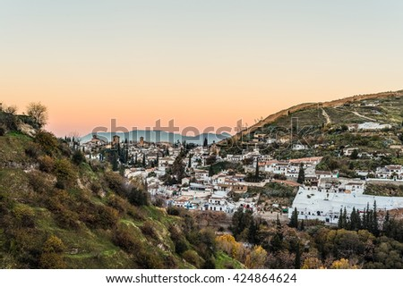 Sacromonte views at sunrise from Avellano Road in the city of Granada, Andalusia, Spain. - stock photo