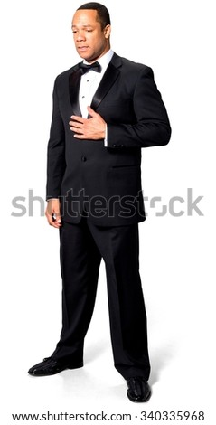 Sad African man with short black hair in evening outfit with hands on stomach - Isolated