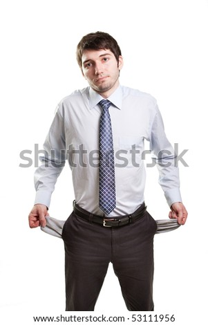 Sad and broke business man with empty pockets - stock photo