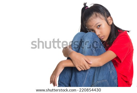 Sad and depressed young Asian girl over white background - stock photo