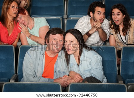 Sad and disgusted groups of people in a theater
