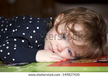 Sad and ill little girl - stock photo