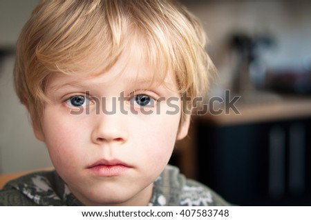 Sad and  lonely little boy - stock photo