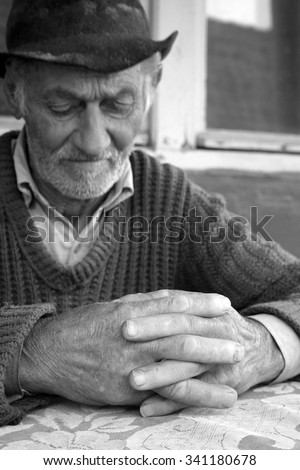 Sad and lonely old man thinking - stock photo