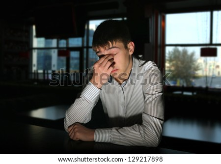 Sad and Lonely Young Man Portrait in Dark Room - stock photo