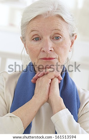 Sad and thoughtful old lady - stock photo