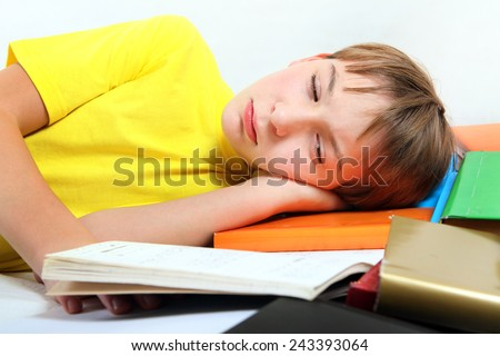 Sad and Tired Kid with the Books on the Bed - stock photo