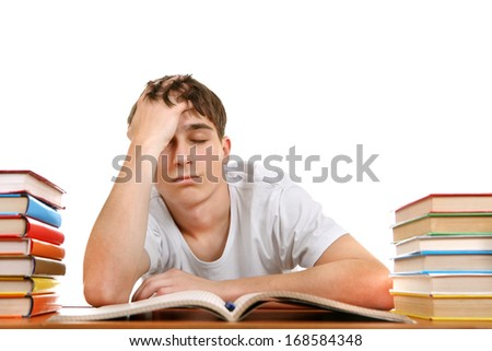 Sad and Tired Student on the School Desk Isolated on the White Background - stock photo